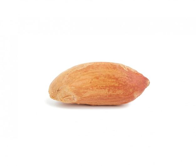 Brown arachidowy nasiono, jedzenie odizolowywający na biel przestrzeni