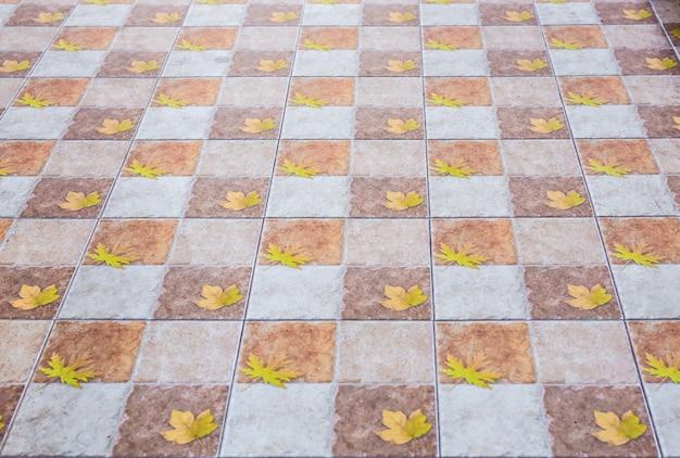 Brown ceramicznych podłogowych płytek zbliżenia tekstura