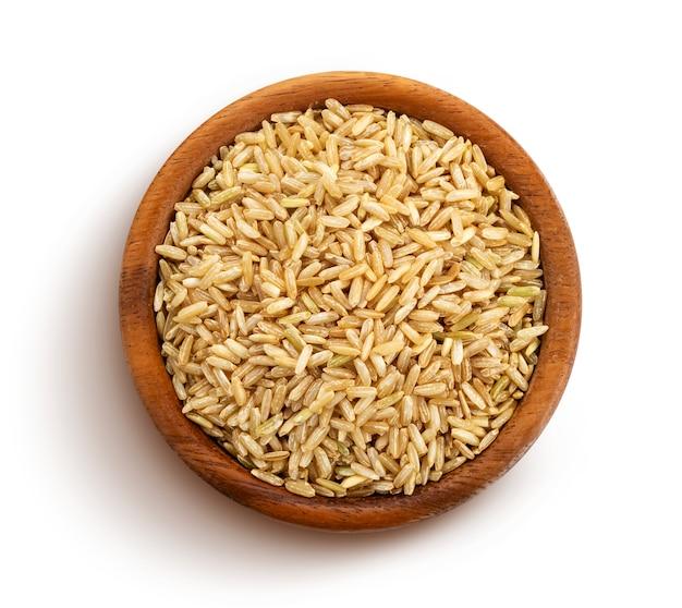 Brown ryżowi kasze odizolowywający na białym, odgórnym widoku ,.