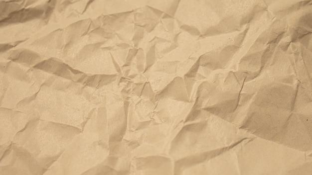 Brown zmięty papieru zakończenie w górę tekstury tła