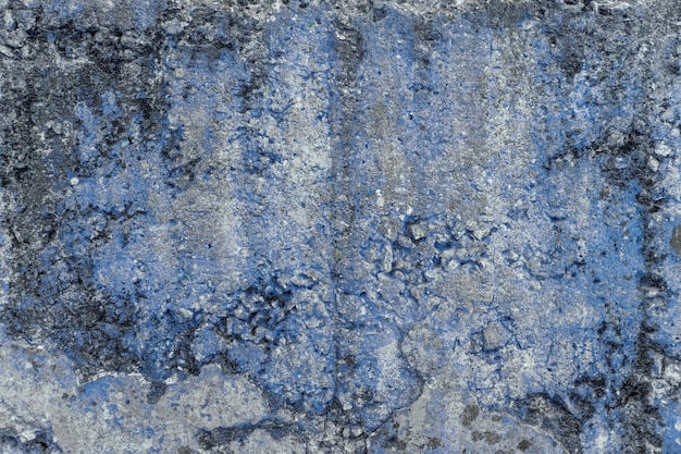 Brudna stara betonowa ściana z jakąś pleśnią. tło. tekstura