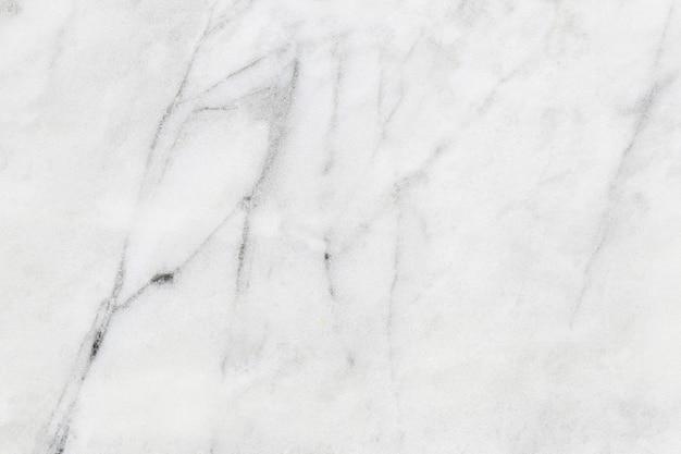 Brudne tekstury białego marmuru mają pył tła i wzór kamienia.