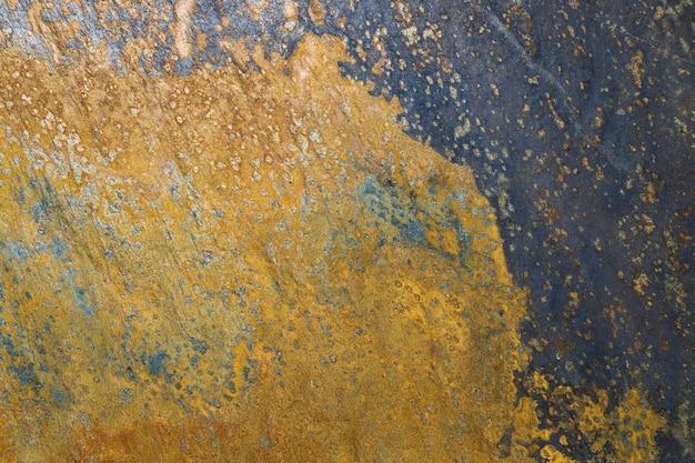 Brudne tło łupków grunge lub tekstura z zadrapaniami i pęknięciami