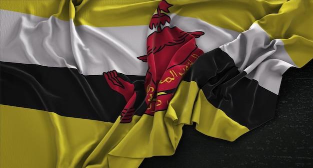 Brunei flaga zgnieciony na ciemnym tle renderowania 3d