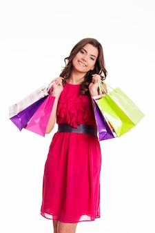 Brunetka kobieta z wielu kolorowych toreb na zakupy