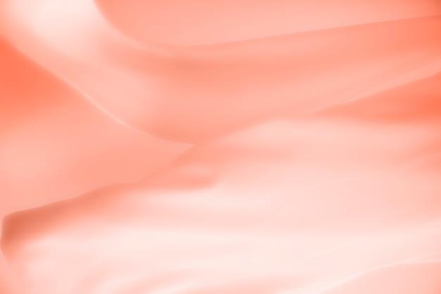 Brzoskwiniowy satynowy materiał tekstury tła