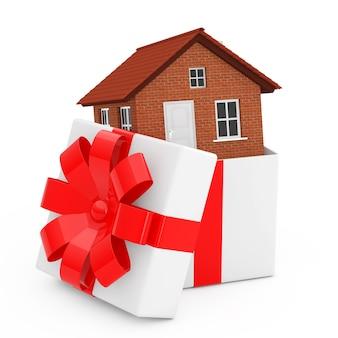 Budynek domu w pudełko z czerwoną wstążką i kokardą na białym tle. renderowanie 3d