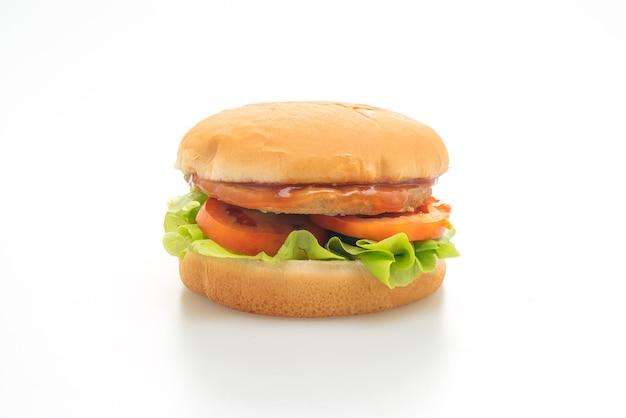 Burger z kurczaka z sosem na białej powierzchni