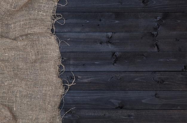 Burlap hessian lub zwolnienie na ciemnym tle drewniane