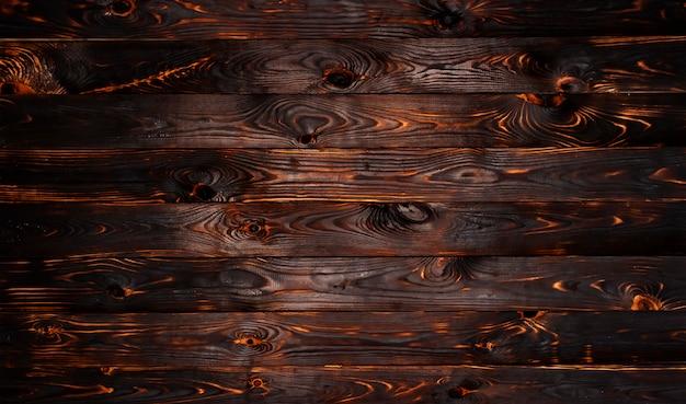 Burnt drewnianej deski tekstury tło