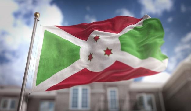Burundi flaga 3d renderowania na tle błękitne niebo budynku