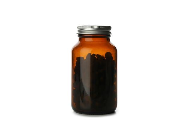 Butelka medyczna z pigułki spiruliny na białym tle
