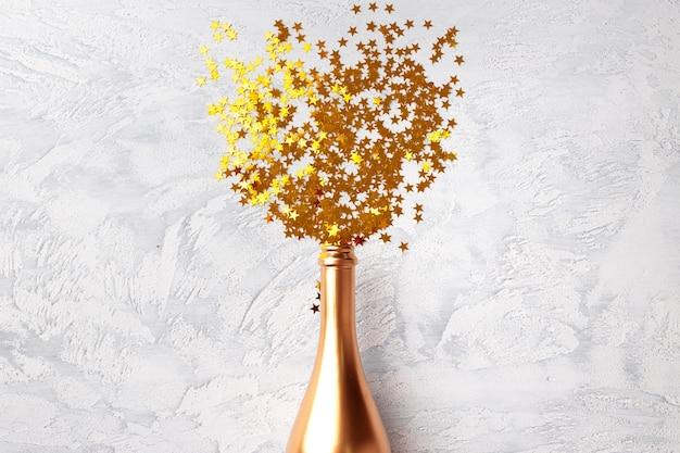 Butelka szampana z konfetti na płasko