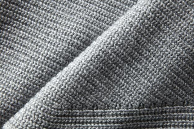 Cała strona z bliska szarej dzianiny sweter tekstury materiału