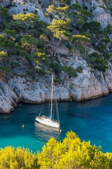 Calanques of port pin with boat, cassis, francja