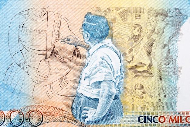 Candido portinari maluje portret ze starych brazylijskich pieniędzy