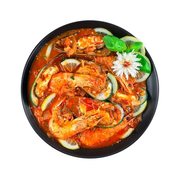Cataplana z owocami morza to specjalne danie (wok) do przygotowania owoców morza w portugalii danie kulinarne styl szczyci się szeroką gamą dekoracji ze słodką bazylią i rzeźbionym porem w kształcie kwiatu z góry