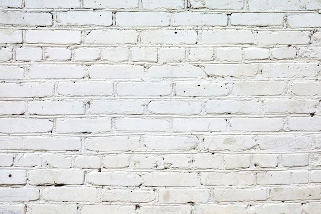 Cegła biała ściana tła grunge. biały mur z cegły w stylu loftu. białe tło ściany z cegły