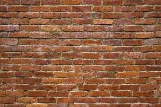 Cegła kamienna ściana czerwonych bloków tła dla projektu