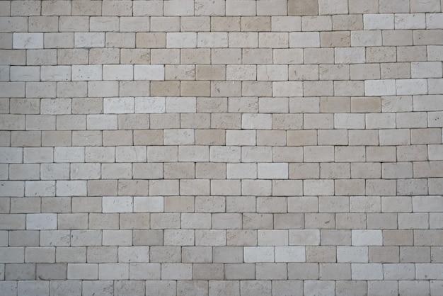 Cegła z szarej, dużej cegły, na zewnątrz. ceglany mur tekstura tło, kopia przestrzeń