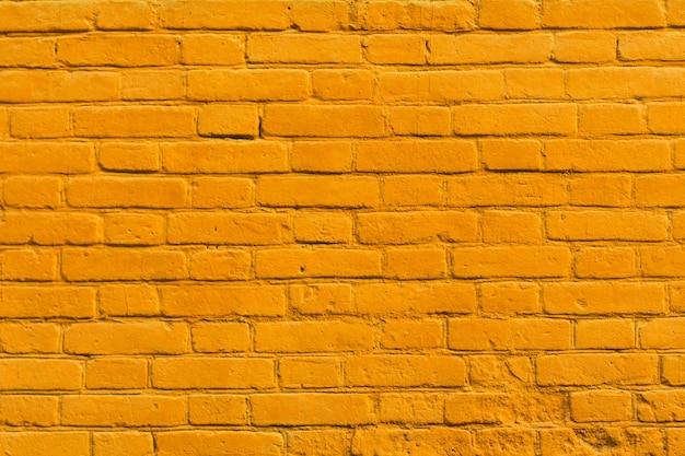 Cegła żółte ściany tekstury tła starego ceglanego domu