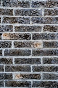 Ceglana ściana. tekstura szarej cegły z białym wypełnieniem