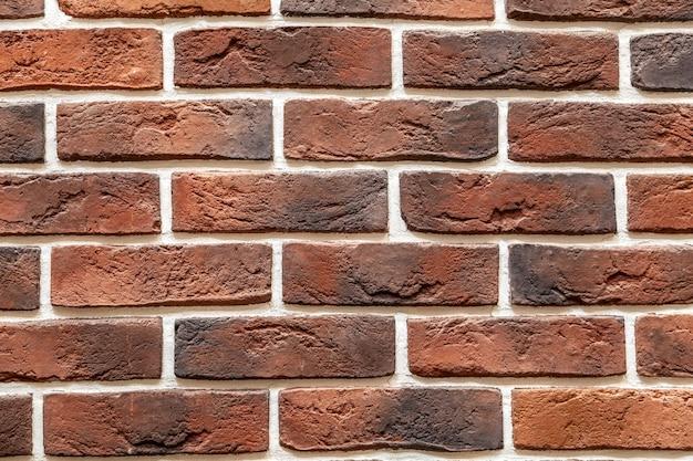Ceglany kamienny mur wykonany z bloków. wzór łupek ściany tekstura i tło