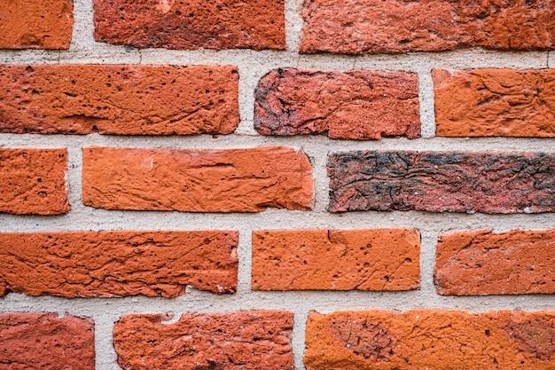 Ceglany mur, zbliżenie starego muru zamkowego, fragmenty domu lub tło z czerwonej cegły. ramka na tło lub tapetę.