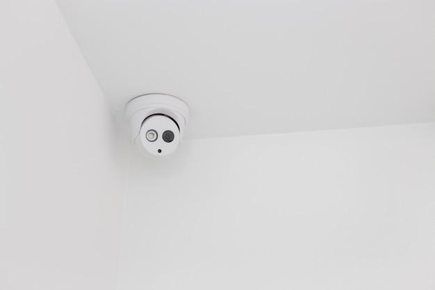 Ceiling corner of white security camera