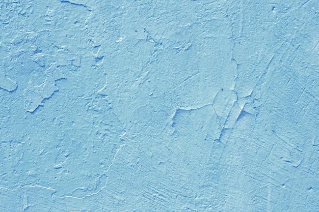 Cement pomalowany na tle ściany, niebiesko-pastelowa tekstura