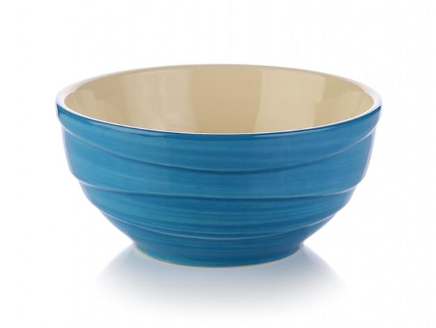 Ceramiczna miska na białej przestrzeni