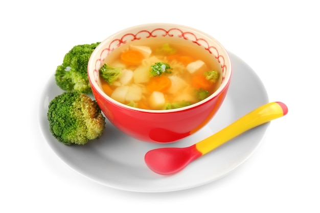 Ceramiczna miska z zupą dla dziecka na białym tle