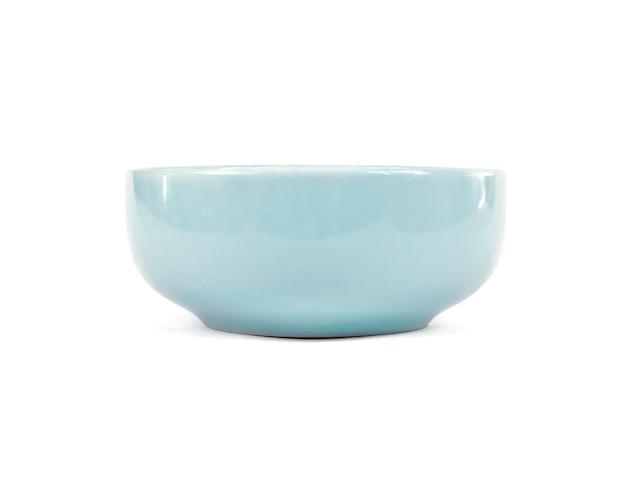 Ceramiczny puchar odizolowywający na białej ścinek ścieżce