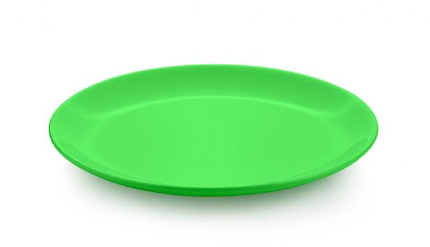 Ceramiczny zielony talerz odizolowywający na biel przestrzeni