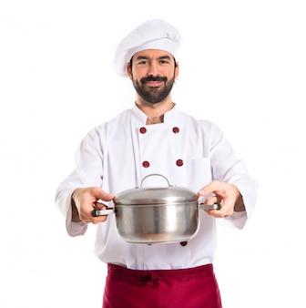 Chef trzyma garnek