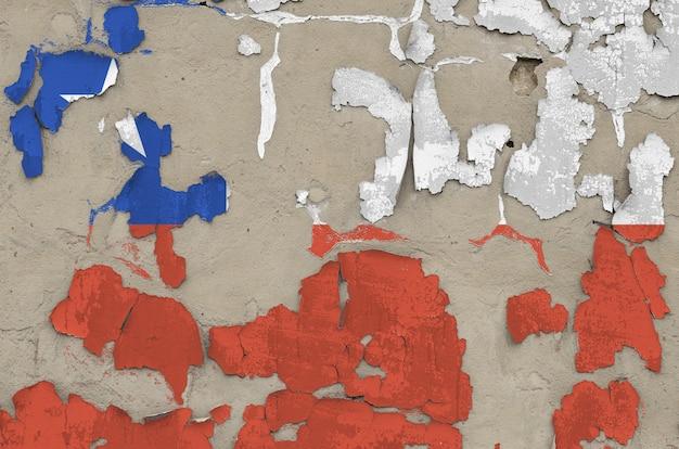 Chile flaga przedstawiająca w farbie barwi na starym przestarzałym upaćkanym betonowej ściany zbliżeniu. teksturowane transparent na szorstkim tle