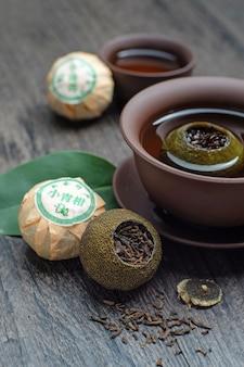 Chiński zielony pomaraczowy puer herbata (chiński tekst: zielona herbata pomarańczowa)