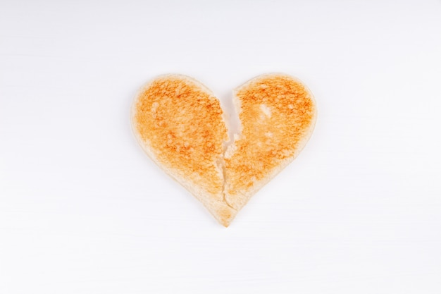 Chleb toast złamane serce symbol, rozwód, zerwanie, koncepcja niezadowolony związek