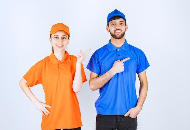 Chłopiec i dziewczynka w niebiesko-żółtych mundurach pokazujący prawą stronę.