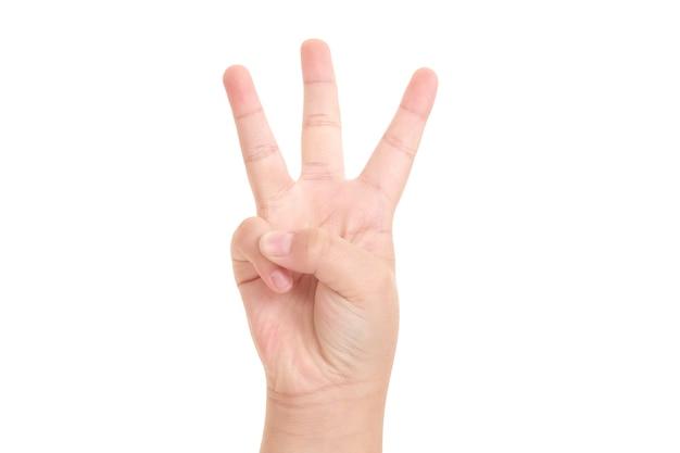 Chłopiec ręka pokazuje symbol trzech palców na na białym tle dla projektanta graficznego.