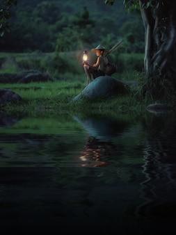 Chłopiec trzyma lampowy patrzeć. abstrakcyjne znaczenie nadziei życia.