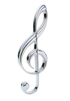 Chromowany klucz wiolinowy na białym tle. symbol muzyczny.