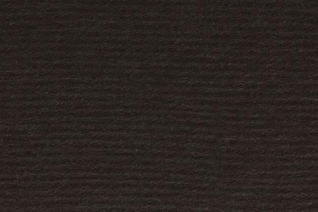Chropowaty pomarszczony czarny papier tło. zdjęcie w wysokiej rozdzielczości.