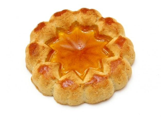 Ciastka w żółtym kolorze z nadzieniem z wielokolorowej galaretki na środku