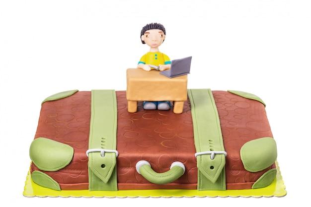 Ciasto walizkę z mężczyzną z pasty cukrowej. na urodziny