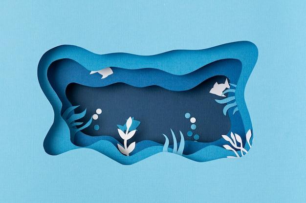 Cięcie papieru na światowy dzień oceanu w głębokim podwodnym morzu. niebieskie życie morskie. uratuj oceany wycinane z ryb i wodorostów na niebieskiej ścianie morskiej. troska o środowisko i ochrona przyrody.