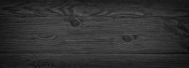Ciemna czarna drewniana tekstura. panoramiczny styl rustykalny vintage. drewno naturalna powierzchnia
