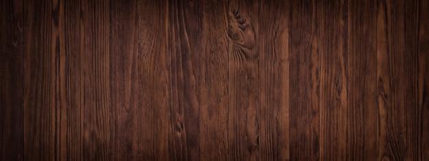 Ciemna powierzchnia drewna powierzchni stołu lub podłogi, ponura faktura drewna