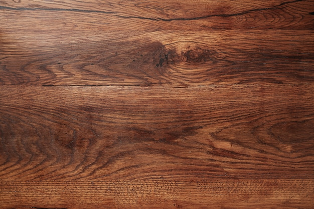 Ciemne drewniane rustykalne tło. drewniany stół.