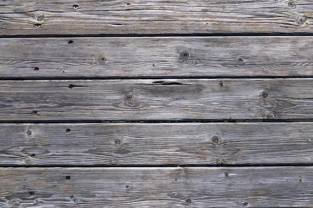 Ciemne drewniane tła tekstury. stare panele ogrodzeniowe z naturalnym pa